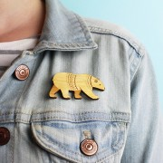 bear brooch wearing