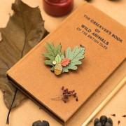 leaf and acorn brooch
