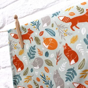 layla amber foxes in the forest tea towel